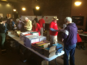 Volunteers prepare school materials for backpack stuffing at Lutheran Church of the Good Shepherd, Jan. 19, 2015